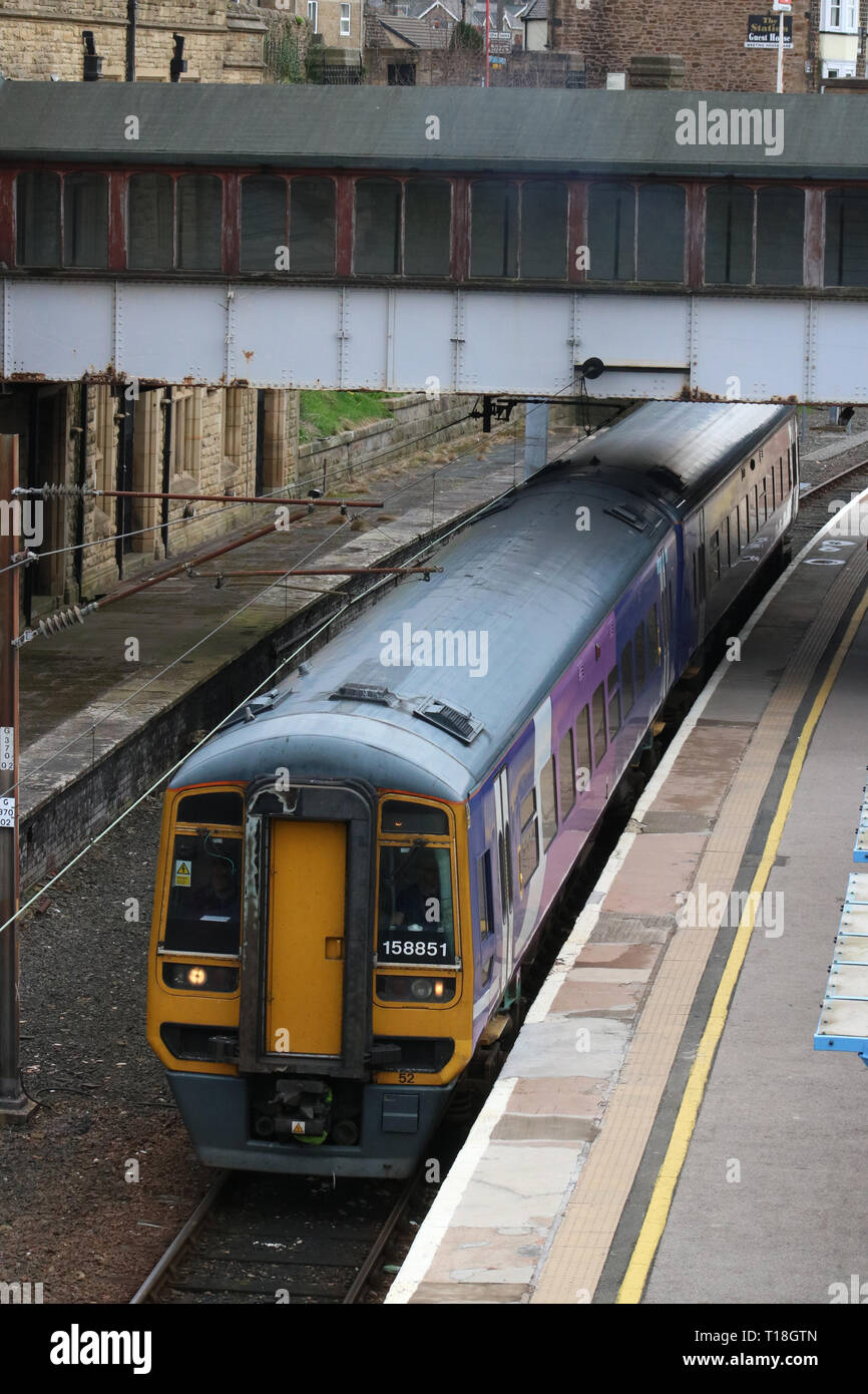 Express sprinter dmu in Northern livery waiting at platform 5 in Lancaster railway station on 21st March 2019 with train for Barrow-in-Furness. - Stock Image