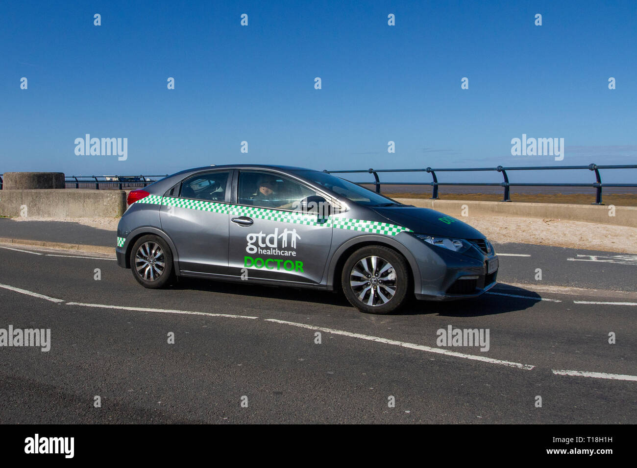 Gtd healthcare Doctor, 2013 Honda Civic I-Dtec SE driving on the seafront promenade, Marine Drive, Southport, Merseyside, UK - Stock Image