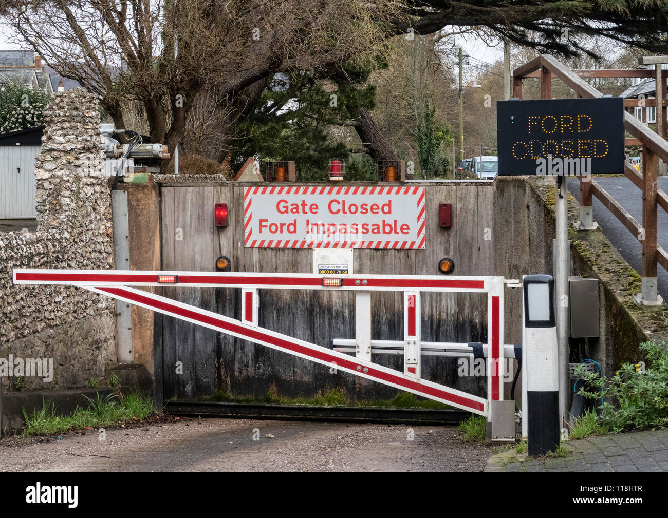 Sign - gate closed, ford impassable, on the river Sid, at Sidmouth, Devon, UK Stock Photo