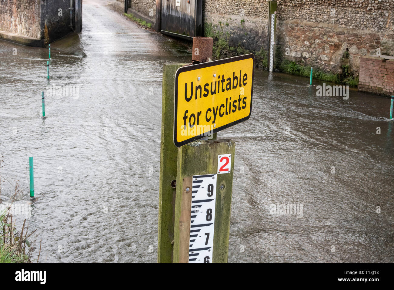 Sign - unsuitable for cyclists, at a ford crossing of the river Sid, in Sidmouth, Devon. Stock Photo