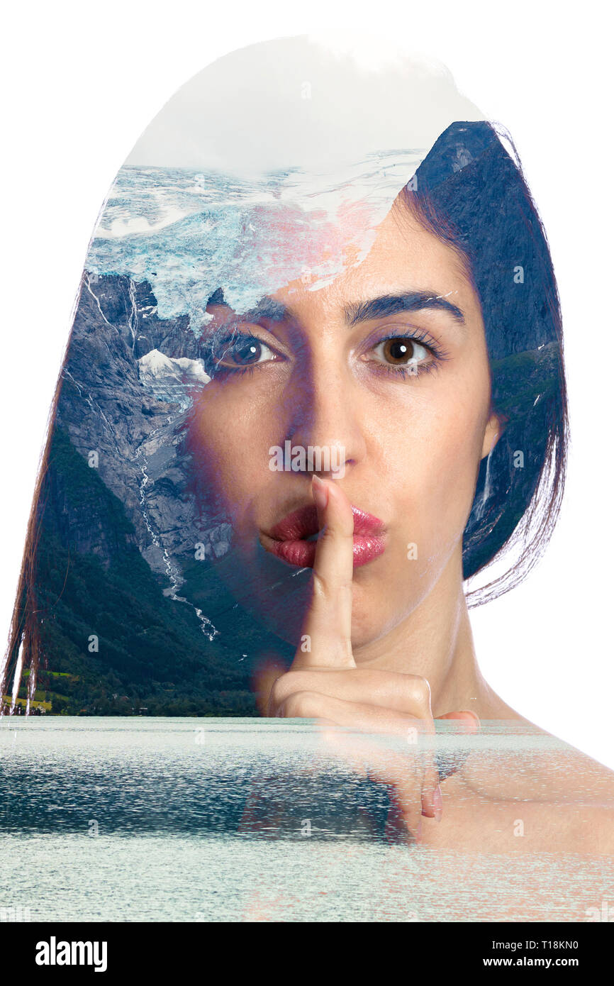 double exposure photo with a girl asking for silence and a glacier melting on the background inside of the girl face. Conceptual photography about cli Stock Photo