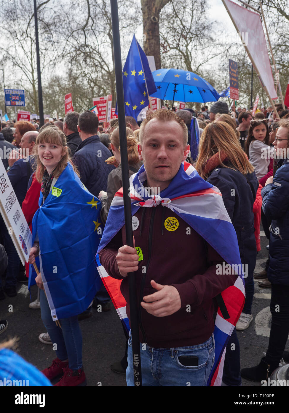 London, England, UK. 23rd March 2019, Anti Brexit Protestor draped in EU Flag on the March in London UK. Credit J Walters/Alamy Live News - Stock Image