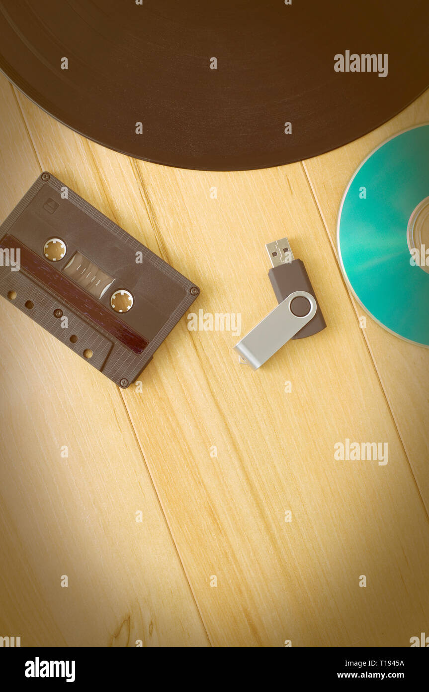 Vintage Look Music Recording Evolution with Cassette USB Key, Vinyl record and CD Stock Photo