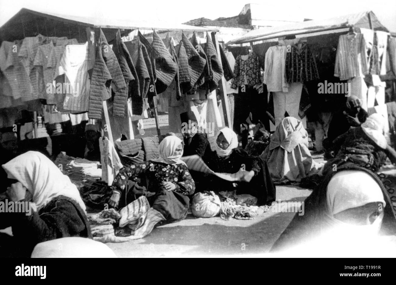 geography / travel historic, Albania, cities and communities, Tirana, markets, clothing retailer on the marketplace, 1930s, Additional-Rights-Clearance-Info-Not-Available - Stock Image