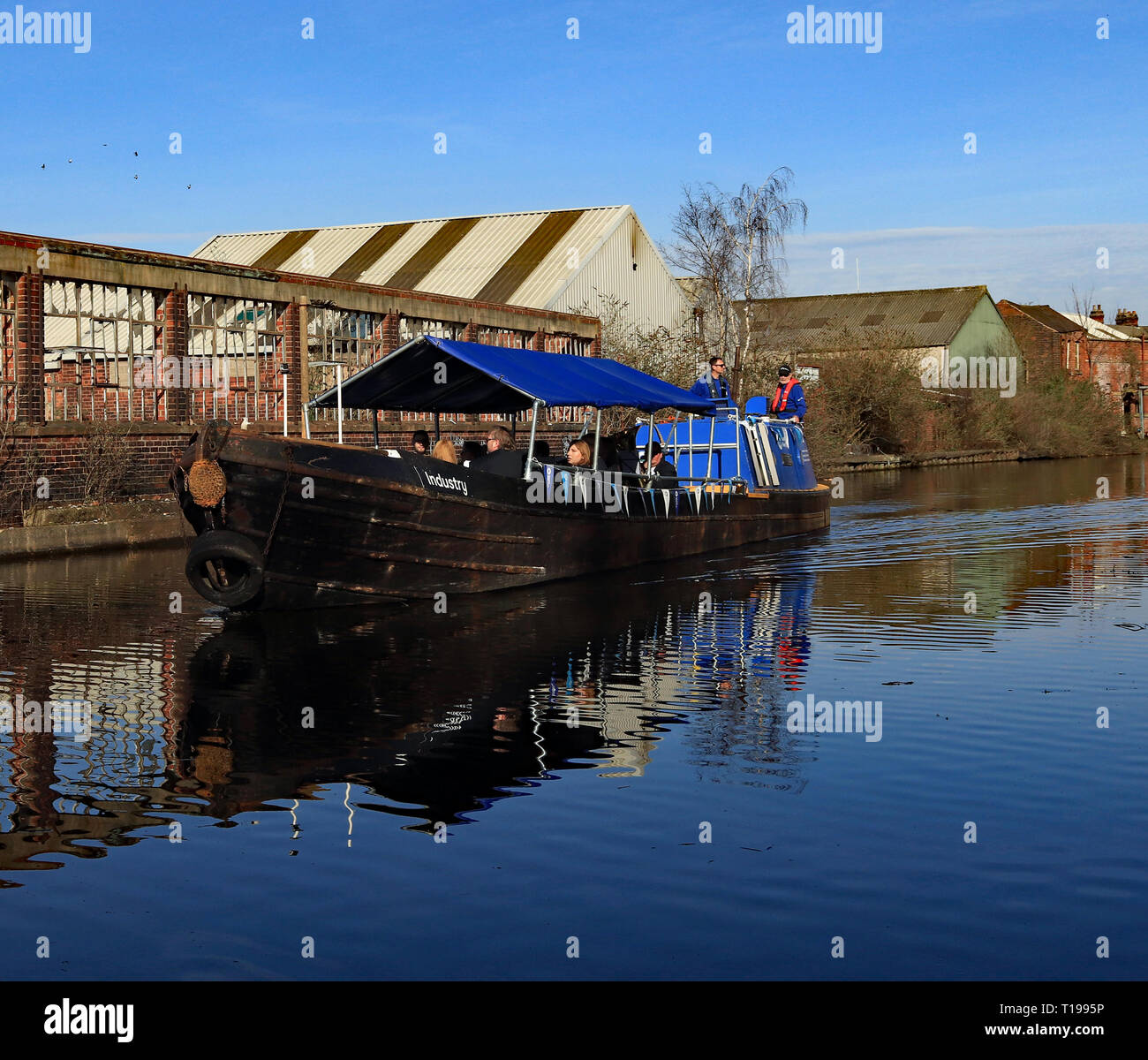 'Industry' passing the factory wall.  200 years ago in 1819 The Sheffield and Tinsley canal opened  and the celebration was recreated in 2019 Cw 6622 - Stock Image