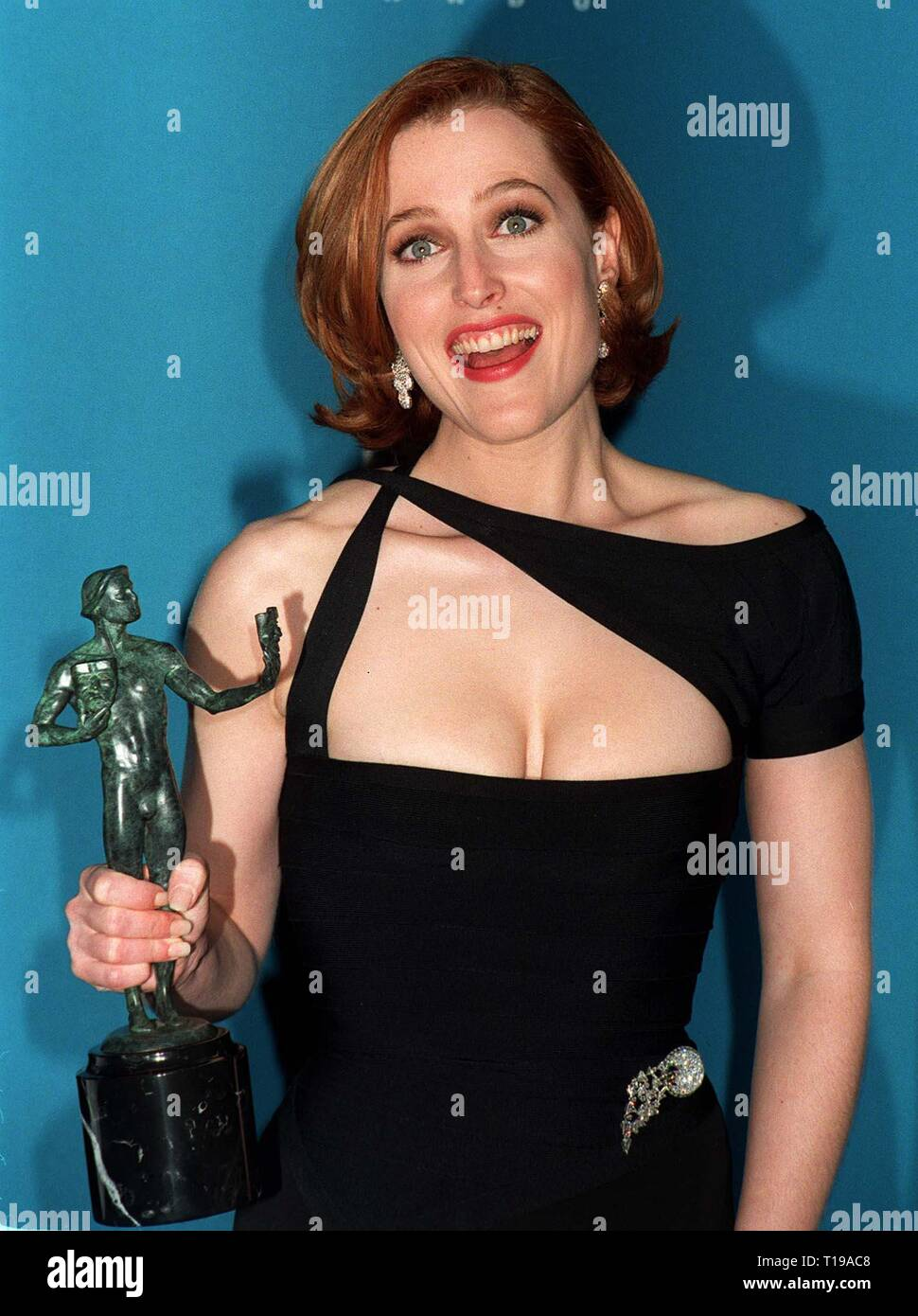 LOS ANGELES, CA. February 23, 1997: X-Files star GILLIAN ANDERSON with her Screen Actors Guild Award for Favorite Actress in a TV Dramatic Series. Pix: PAUL SMITH - Stock Image