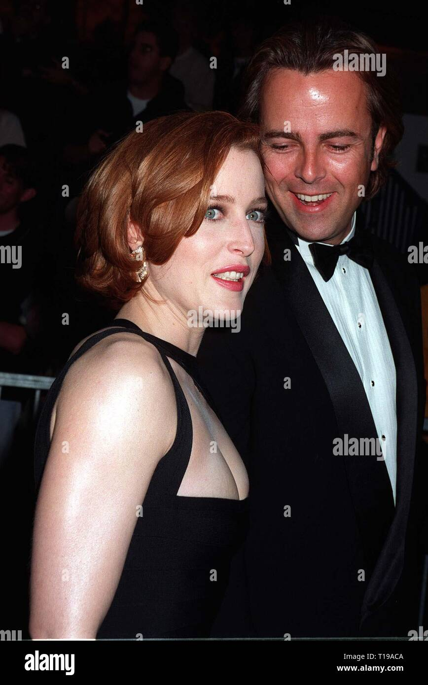 LOS ANGELES, CA. February 22, 1997:  X-Files star GILLIAN ANDERSON & boyfriend RANDY at the Screen Actors Guild Awards  in Los Angeles. Pix: PAUL SMITH - Stock Image
