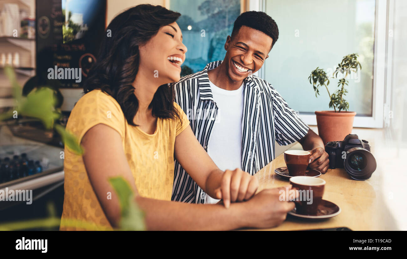 Male And Female Friends Talking And Smiling At Cafe Creative People Meet Up At Cafe Having A Great Time Together Stock Photo Alamy