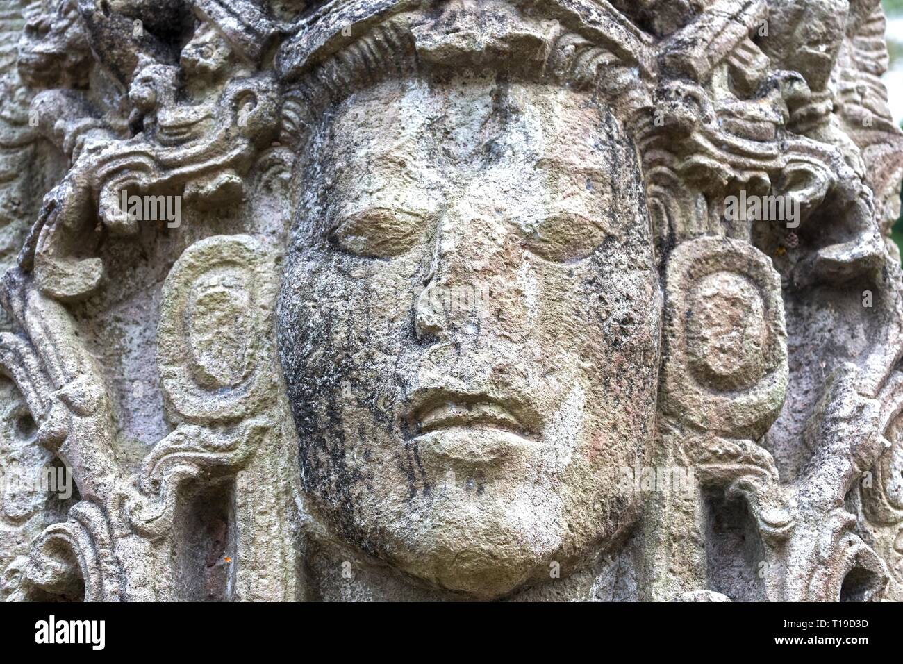 Mayan Face Carved in Stone Temple, World Famous Copan Ruins Archeological Site of ancient Maya Civilization, a UNESCO World Heritage Site in Honduras - Stock Image
