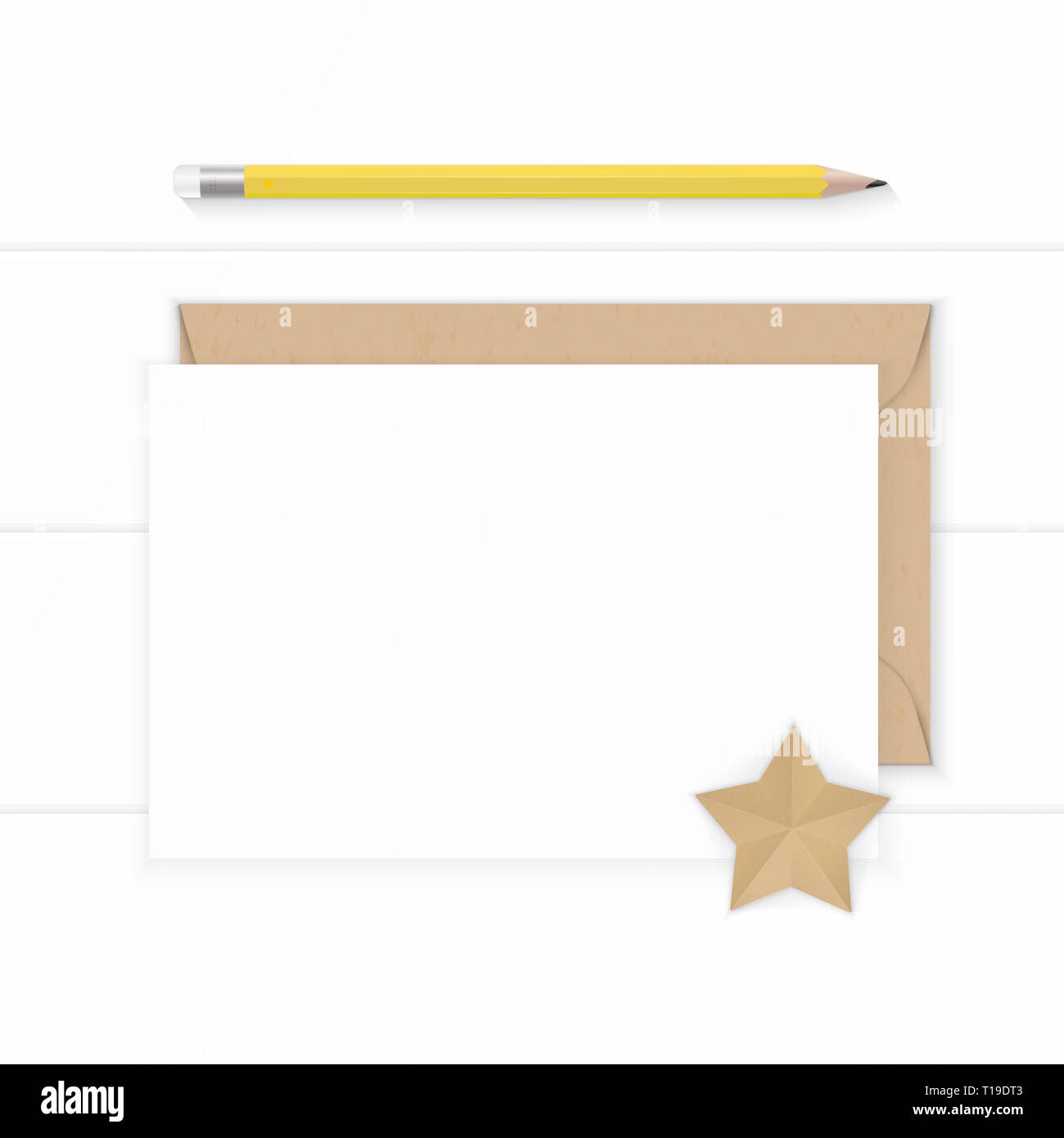 Flat lay top view elegant white composition paper kraft envelope and yellow pencil on wooden background. Stock Photo