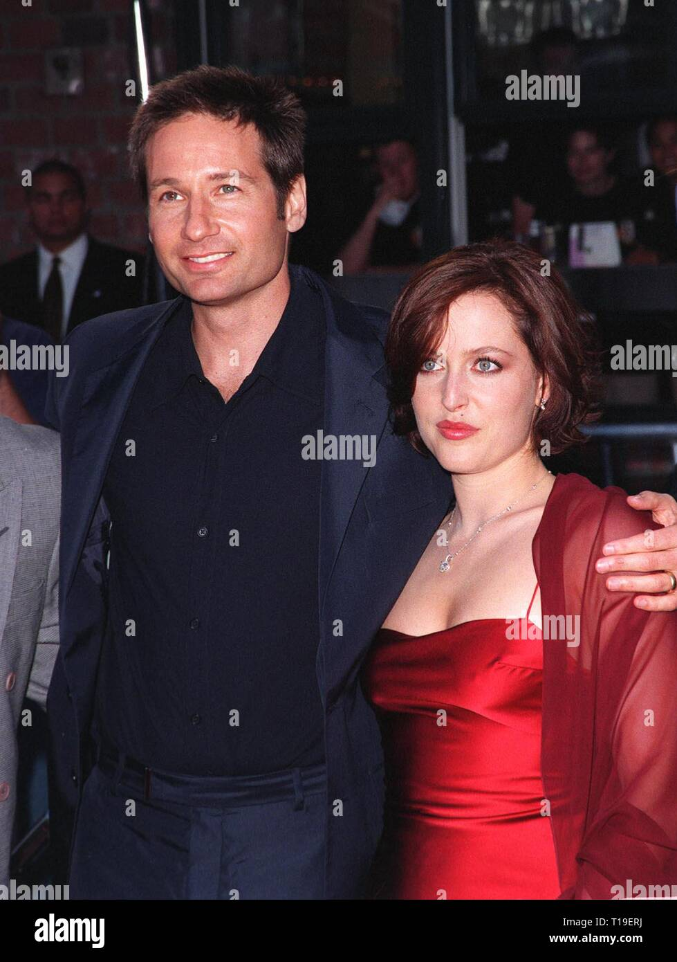 """LOS ANGELES, CA - September 8, 2011:  Actor DAVID DUCHOVNY & actress GILLIAN ANDERSON at the world premiere, in Los Angeles, of their movie """"The X-Files."""" Stock Photo"""