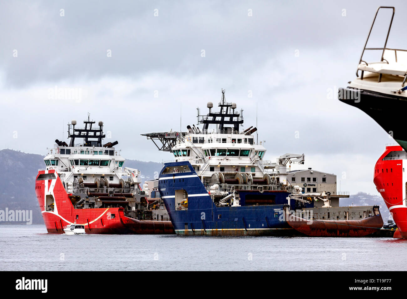 Two AHTS anchor handling tug supply vessesl Normand Drott and KL Saltfjord moored at Skolten terminal, port of Bergen, Norway. - Stock Image