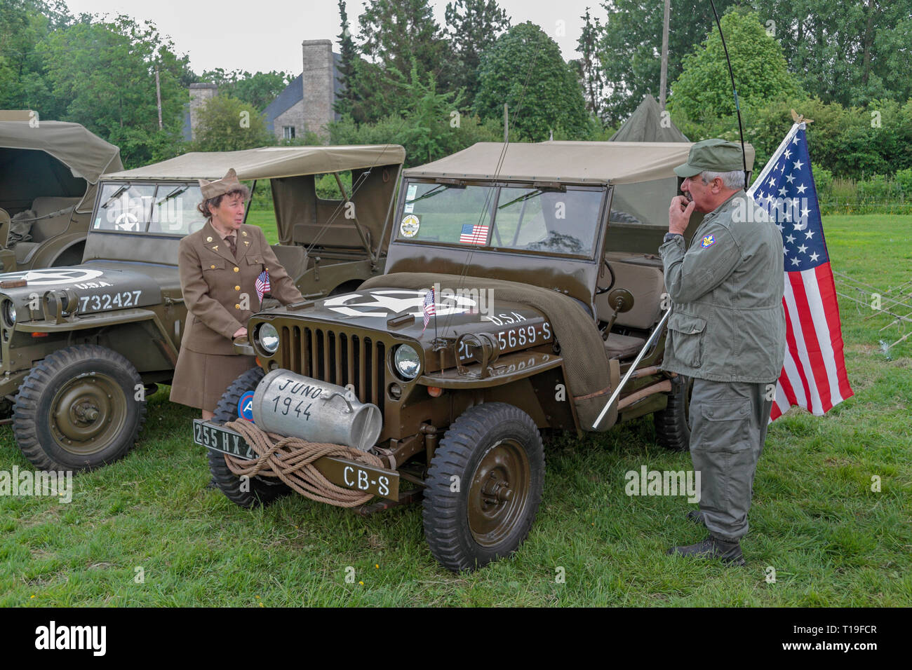 A Willys MB jeep part of the D-Day 70th Anniversary events, re-enactors and vehicle displays in Sainte-Mère-Église, Normandy, France in June 2014. Stock Photo