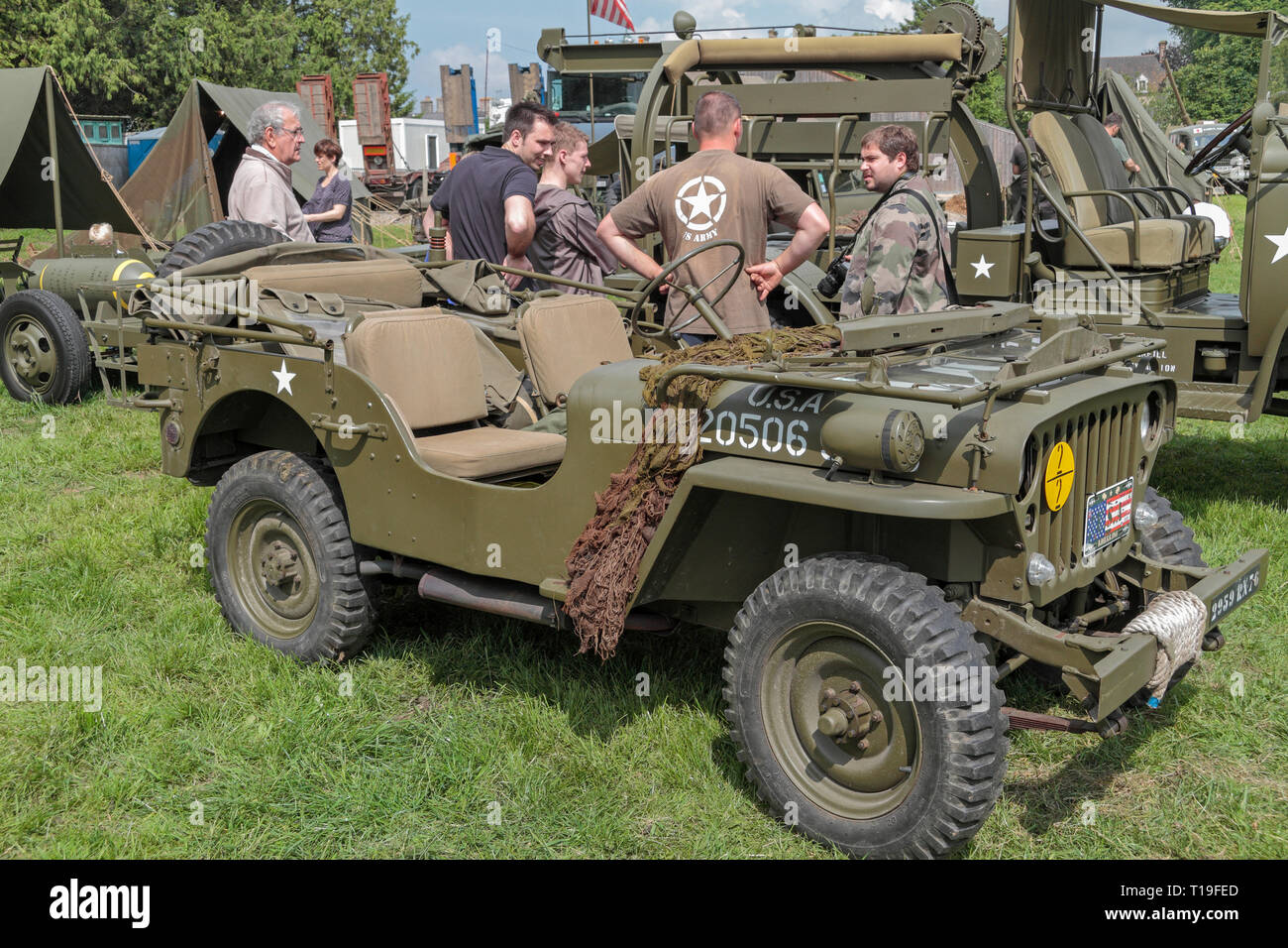 A Willys MB jeep, part of the D-Day 70th Anniversary events, re-enactors and vehicle displays in Sainte-Mère-Église, Normandy, France in June 2014. Stock Photo