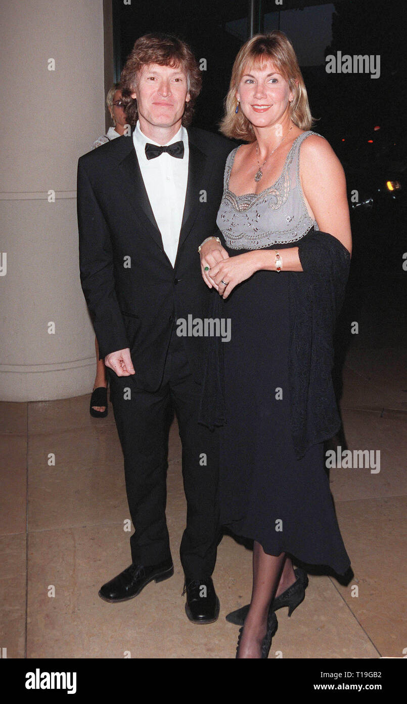 LOS ANGELES, CA - October 12, 1998: Pop star STEVE WINWOOD & wife at the International Achievement in Arts Awards in Beverly Hills. The event benefitted the Whitney Houston Foundation for Children. - Stock Image