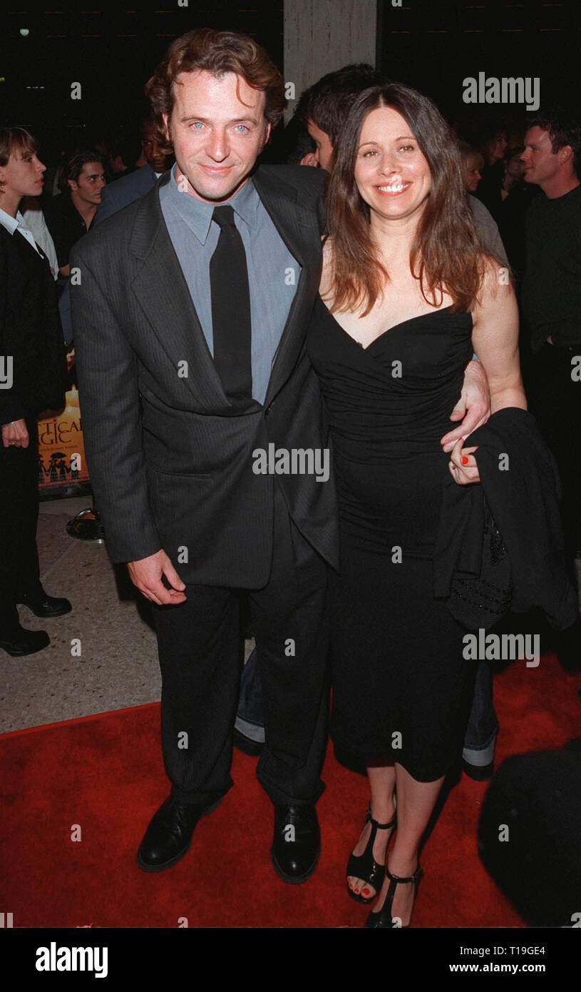 LOS ANGELES, CA - October 13, 1998:  Actor AIDAN QUINN & wife Elizabeth Bracco at the Los Angeles premiere of 'Practical Magic' in which he stars with Sandra Bullock, Nicole Kidman & Stockard Channing. - Stock Image