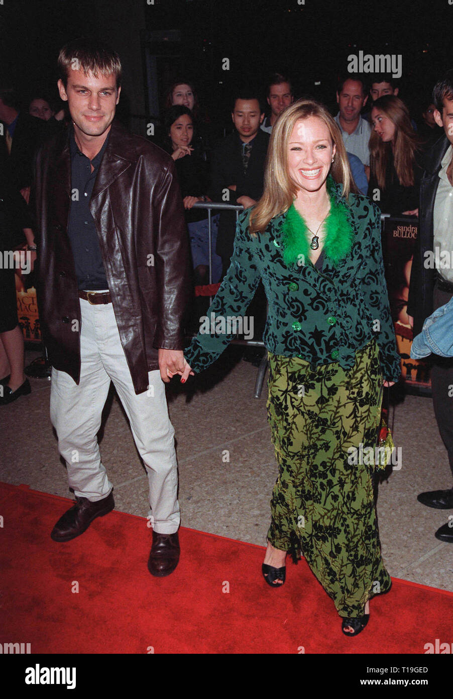 LOS ANGELES, CA - October 13, 1998:  Actress LAUREN HOLLY & date at the Los Angeles premiere of  'Practical Magic' which stars Sandra Bullock, Nicole Kidman, Aidan Quinn & Stockard Channing. - Stock Image