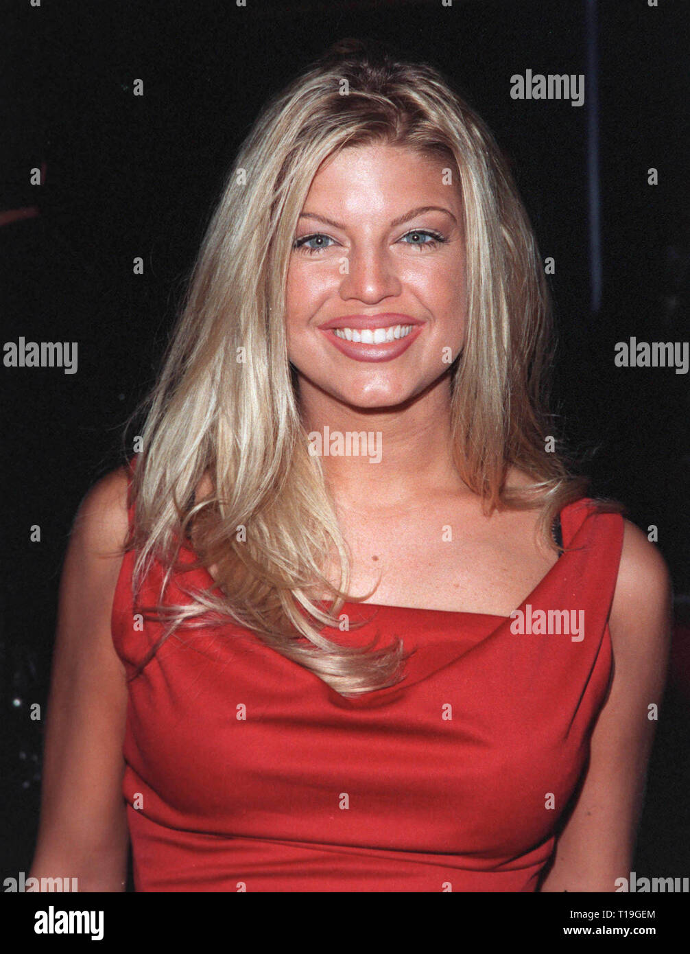 LOS ANGELES, CA - October 13, 1998:  Singer STACY FERGUSON at the Los Angeles premiere of 'Practical Magic' which stars Sandra Bullock, Nicole Kidman, Aidan Quinn & Stockard Channing. - Stock Image