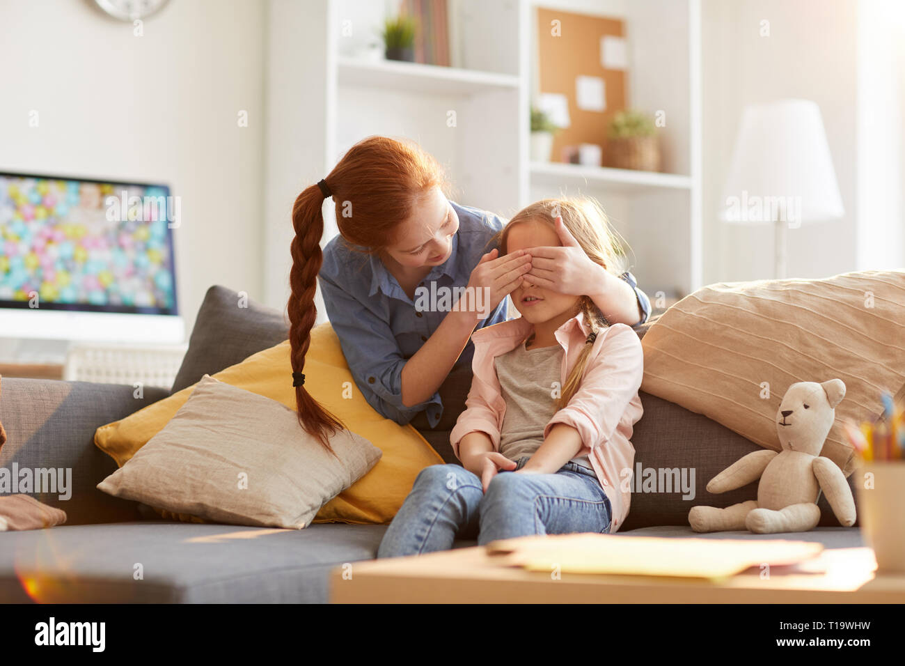Sisters Playing Peek a boo - Stock Image
