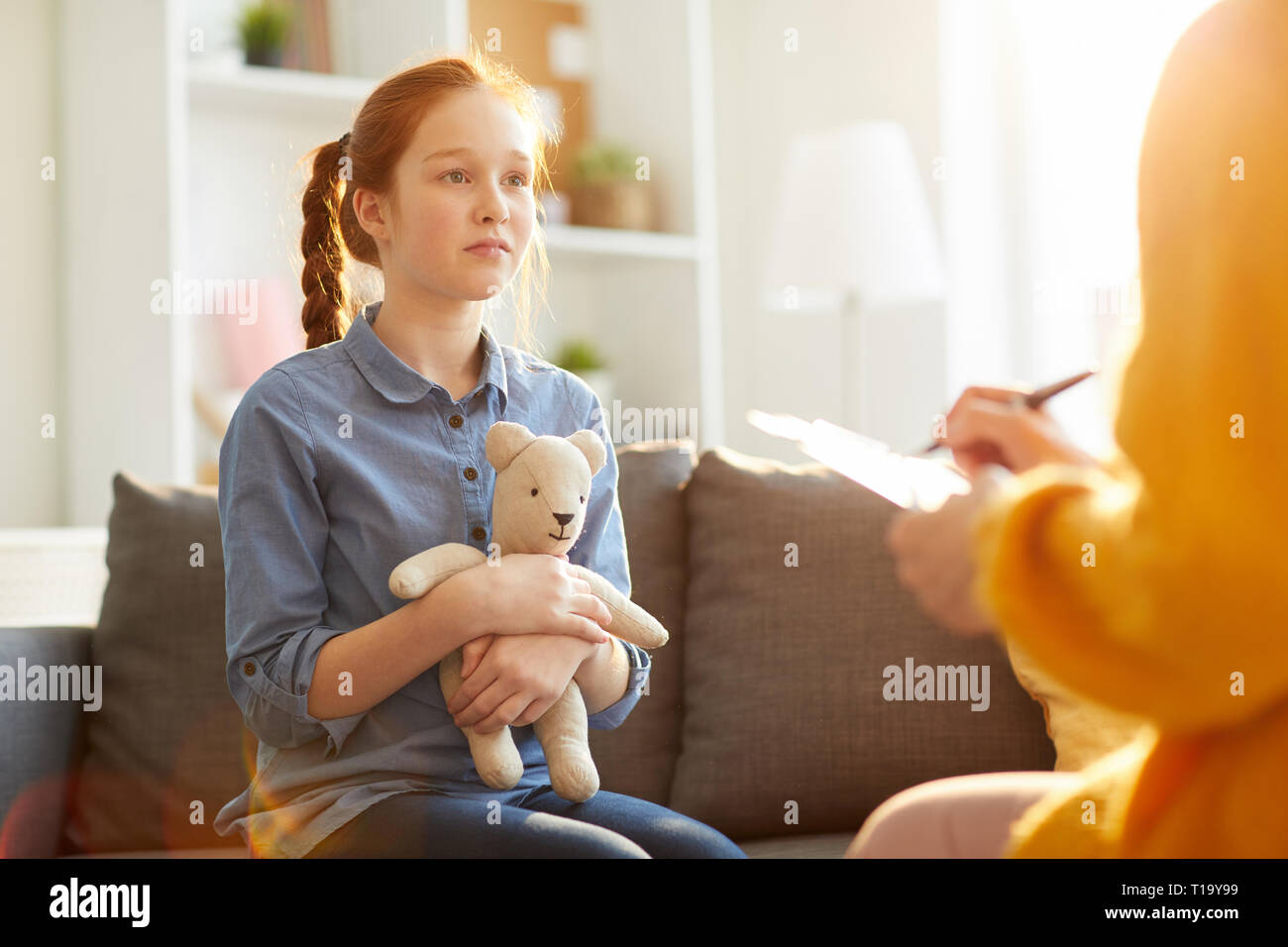 Teenager in Therapy Session - Stock Image