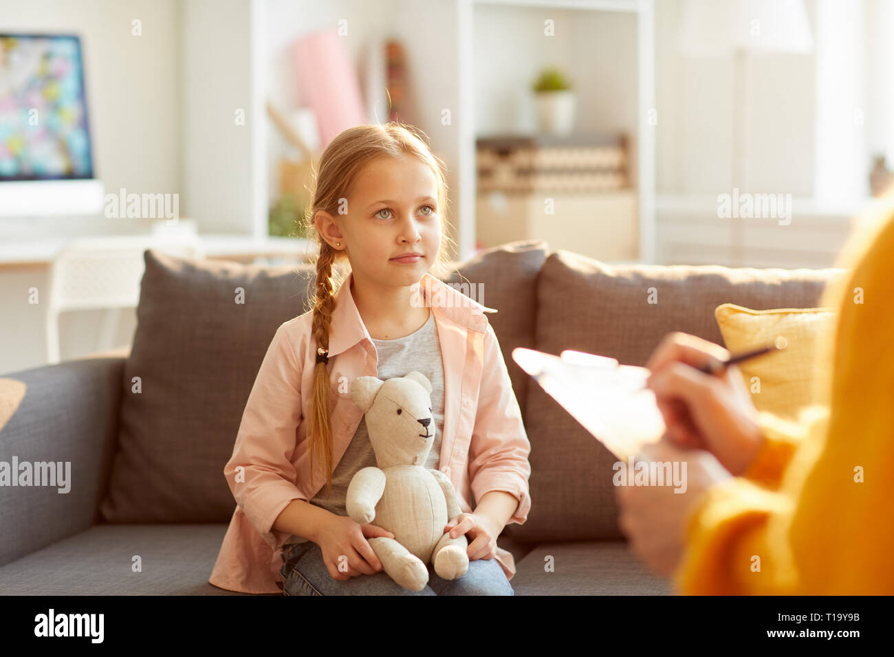 Little Girl in Therapy Session - Stock Image