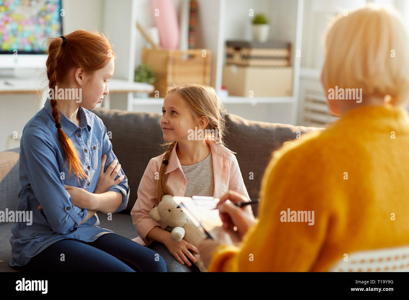 Sisters in Therapy Session - Stock Image