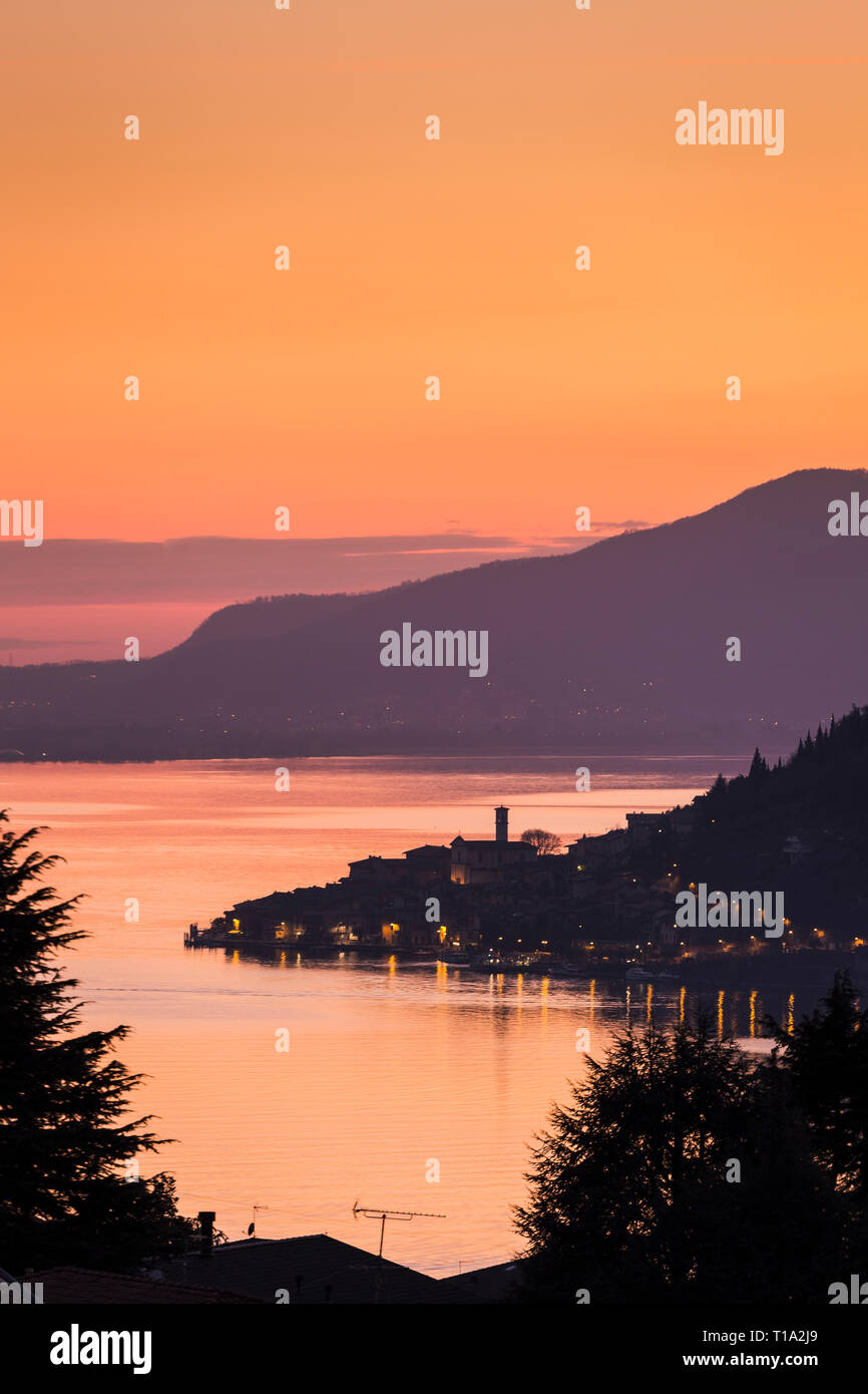 Lake Iseo with the town of Peschiera Maraglio on Monte Isola at dusk, Lombardy, Italy - Stock Image