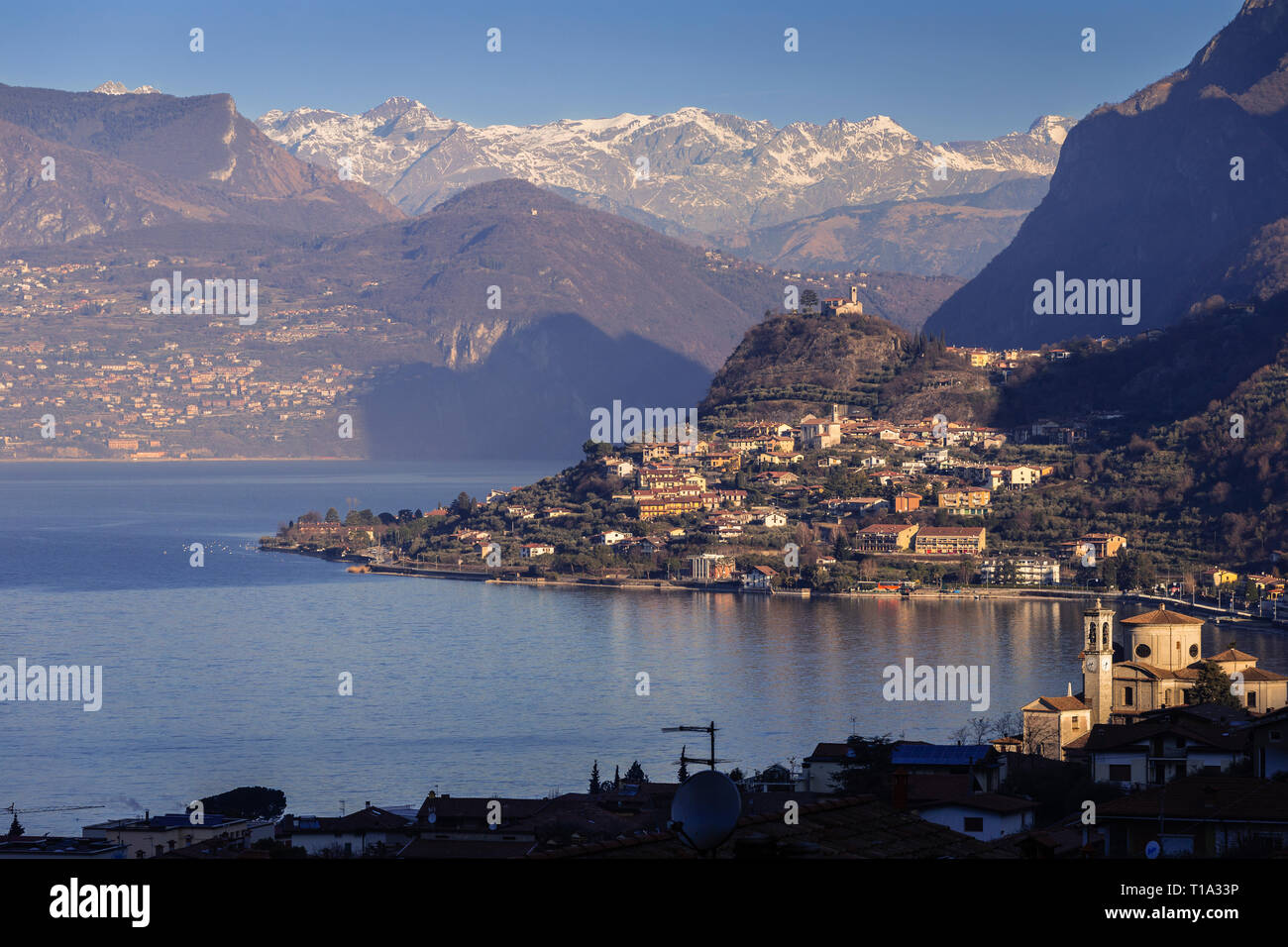 Lake Iseo seen from Sale Marasino to the north and the Alps Stock Photo