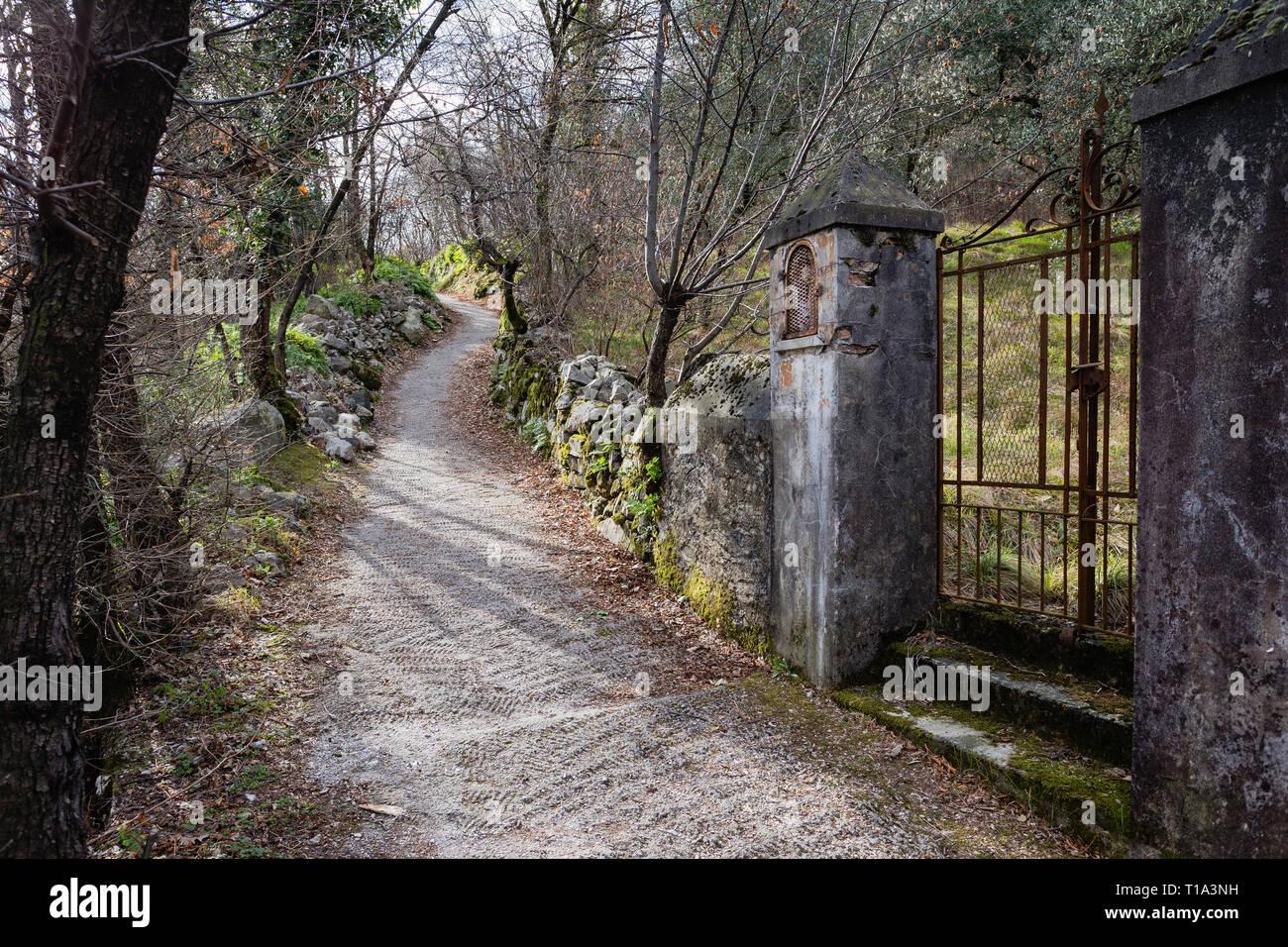 Pathway on Mote Isola island, Lake Iseo, Lombardy, Italy - Stock Image