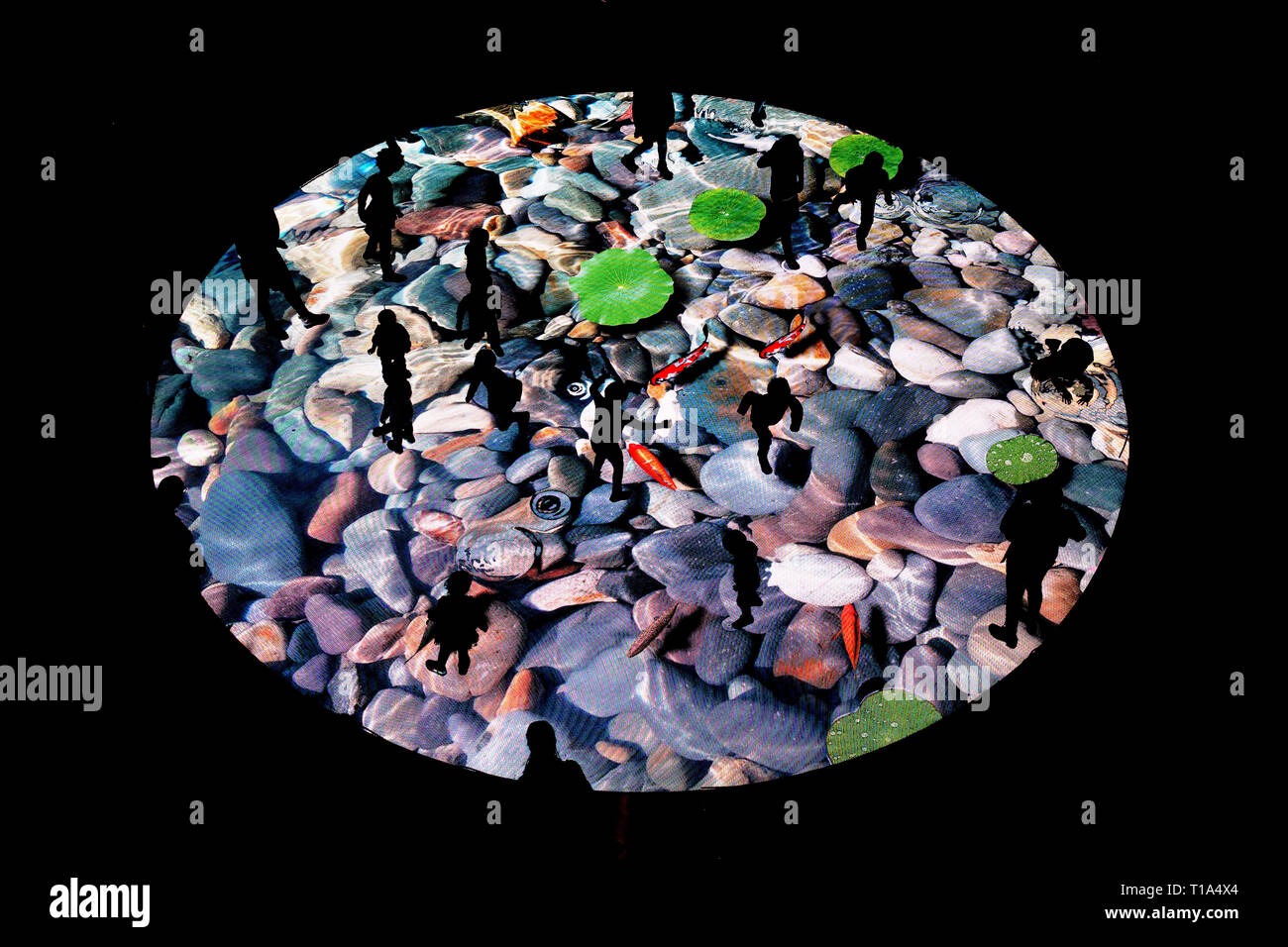 Visitors playing with interactive digital screen at Arenas shopping centre, Barcelona, Spain. - Stock Image