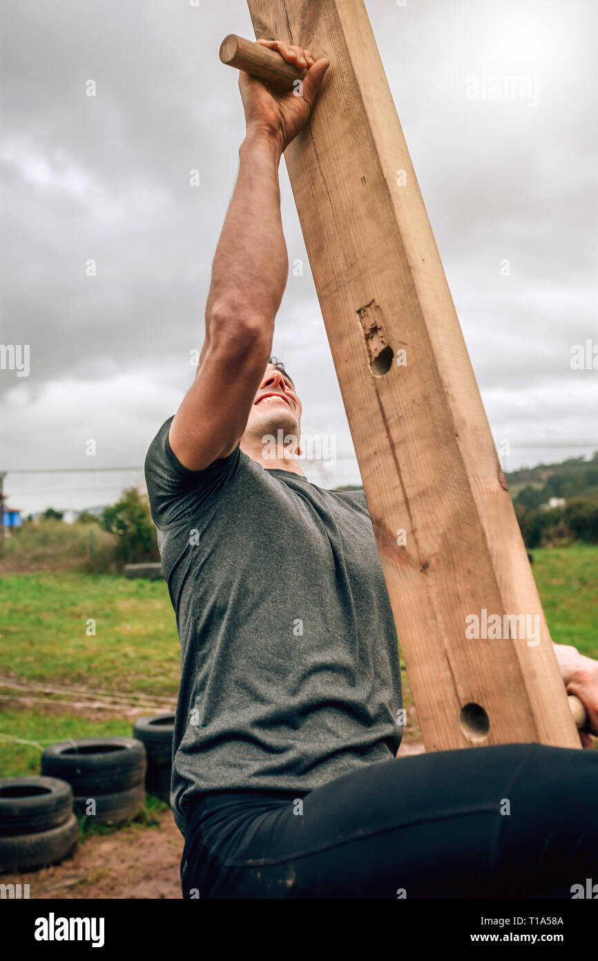 Participant in a obstacle course doing pegboard - Stock Image