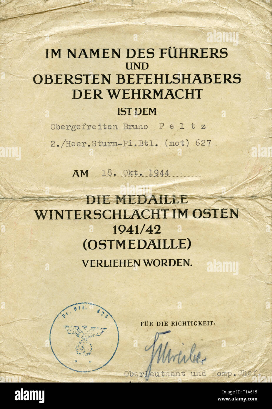 Germany, WW II, war against the Soviet Union, document for the so called east-medal of the battle in wintertime 1941/1942, the document is creased, because it has to be in a uniform / pocket., Additional-Rights-Clearance-Info-Not-Available - Stock Image