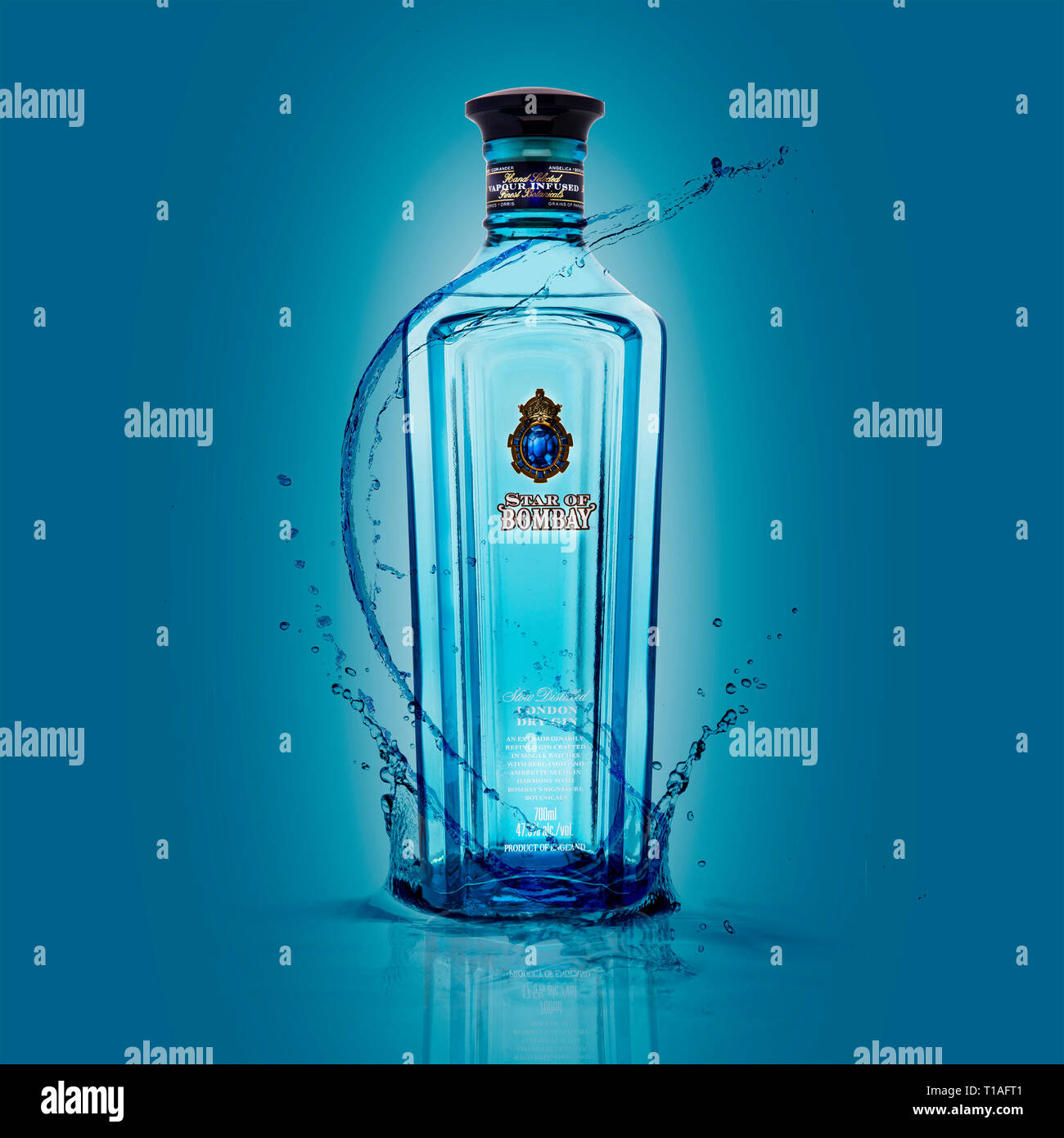 SWINDON, UK - MARCH 24, 2019: Star Of Bombay London Dry Gin with splashes on a blue background - Stock Image