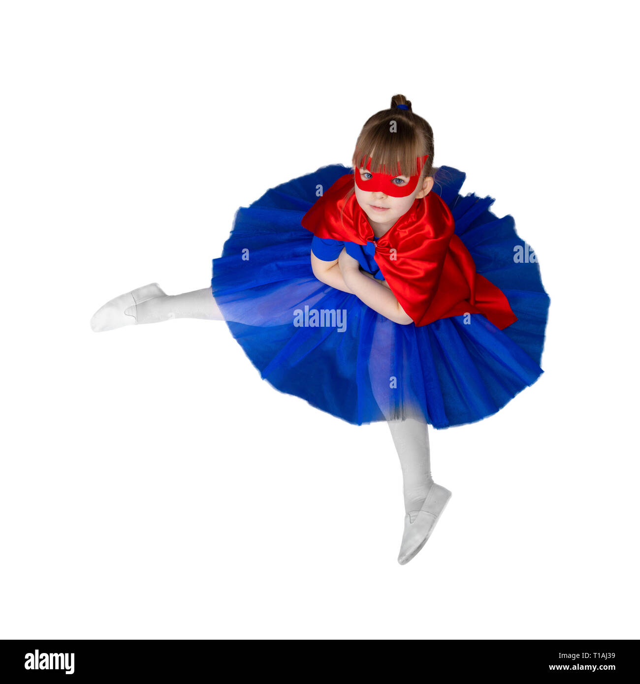 girl super hero with a mask is sitting Isolated on white - Stock Image