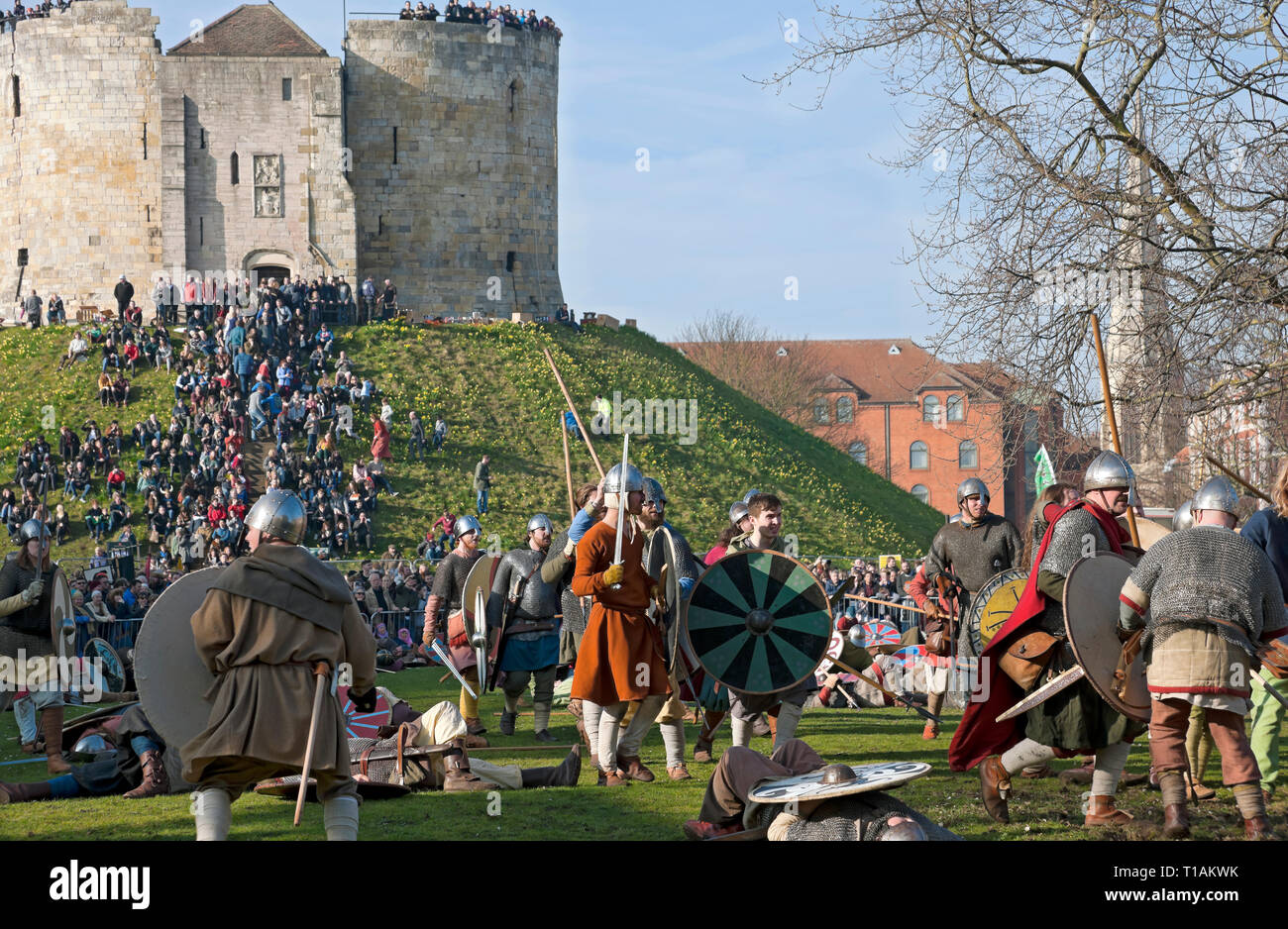 Battle between Vikings and Anglo Saxons at the Viking Festival Clifford's Tower York North Yorkshire England UK United Kingdom GB Great Britain Stock Photo