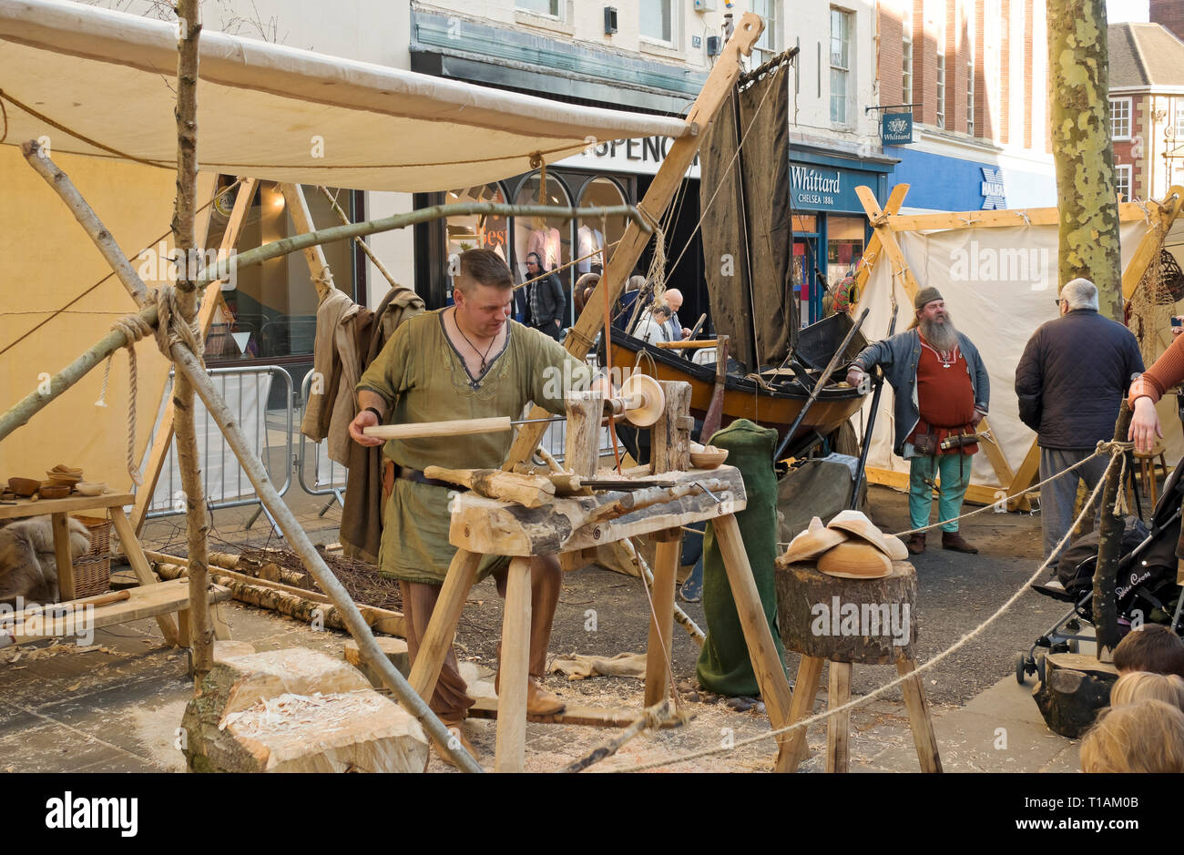 Man demonstrating wood turning at the Viking Festival York North Yorkshire England UK United Kingdom GB Great Britain Stock Photo