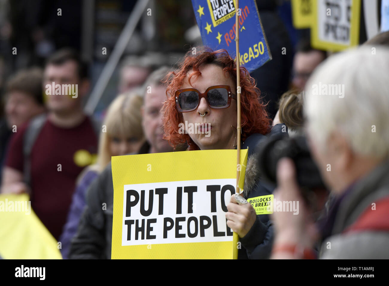 London, Greater London, UK. 23rd Mar, 2019. A protester seen holding a placard that says ''Put it to the people'' during the march.Over a million people marched peacefully in central London in favor of a second referendum. People gathered at Park Lane to rally at Parliament Square to demonstrate against the Tory government's Brexit negotiations, and to demand a second vote on the final Brexit deal. March was organized by The Peoples Vote. Credit: Andres Pantoja/SOPA Images/ZUMA Wire/Alamy Live News - Stock Image