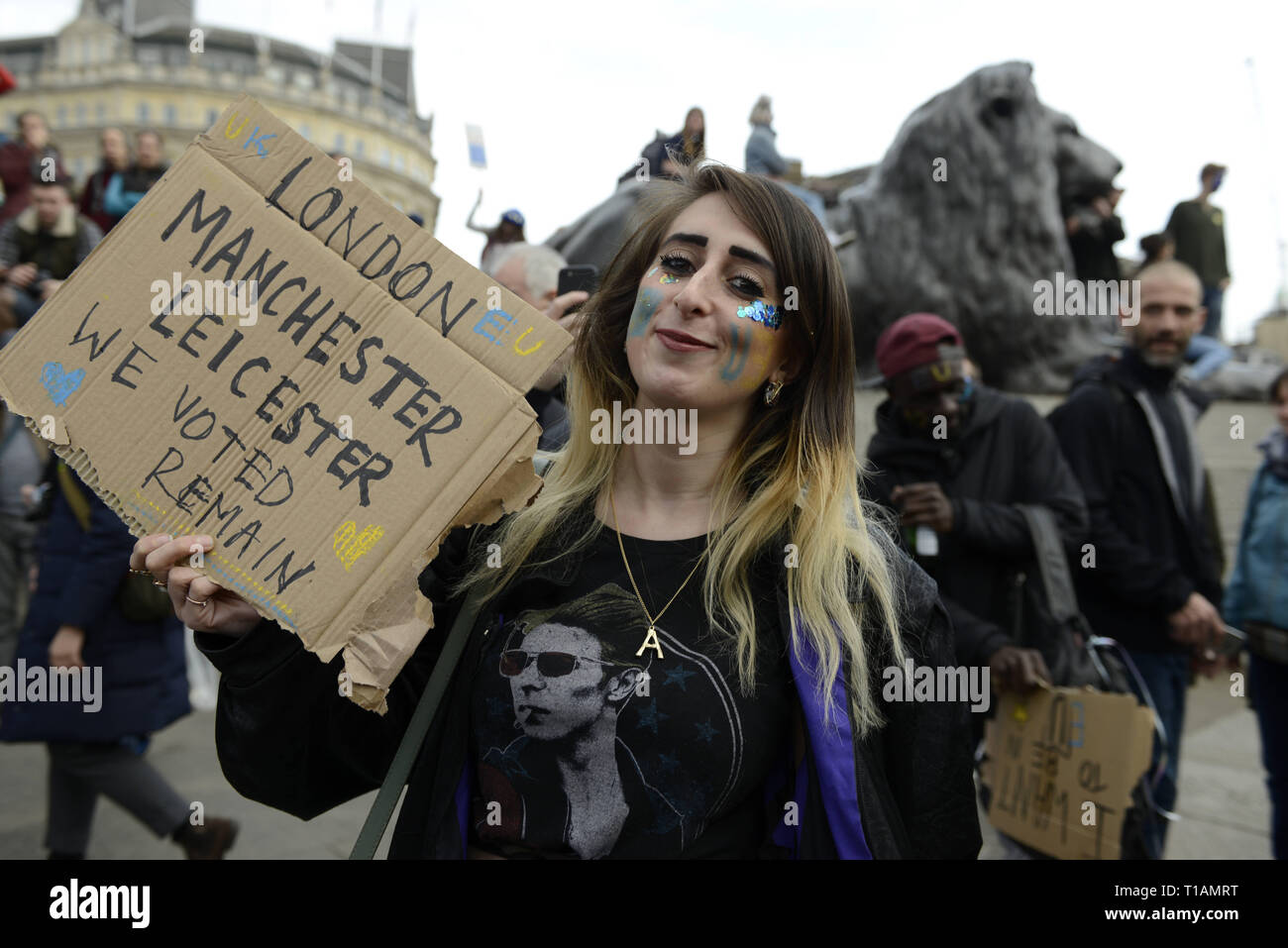 London, Greater London, UK. 23rd Mar, 2019. A protester seen holding a placard that says 'Manchester, Leicester we voted remain'' during the protest.Over a million people marched peacefully in central London in favor of a second referendum. People gathered at Park Lane to rally at Parliament Square to demonstrate against the Tory government's Brexit negotiations, and to demand a second vote on the final Brexit deal. March was organized by The Peoples Vote. Credit: Andres Pantoja/SOPA Images/ZUMA Wire/Alamy Live News - Stock Image