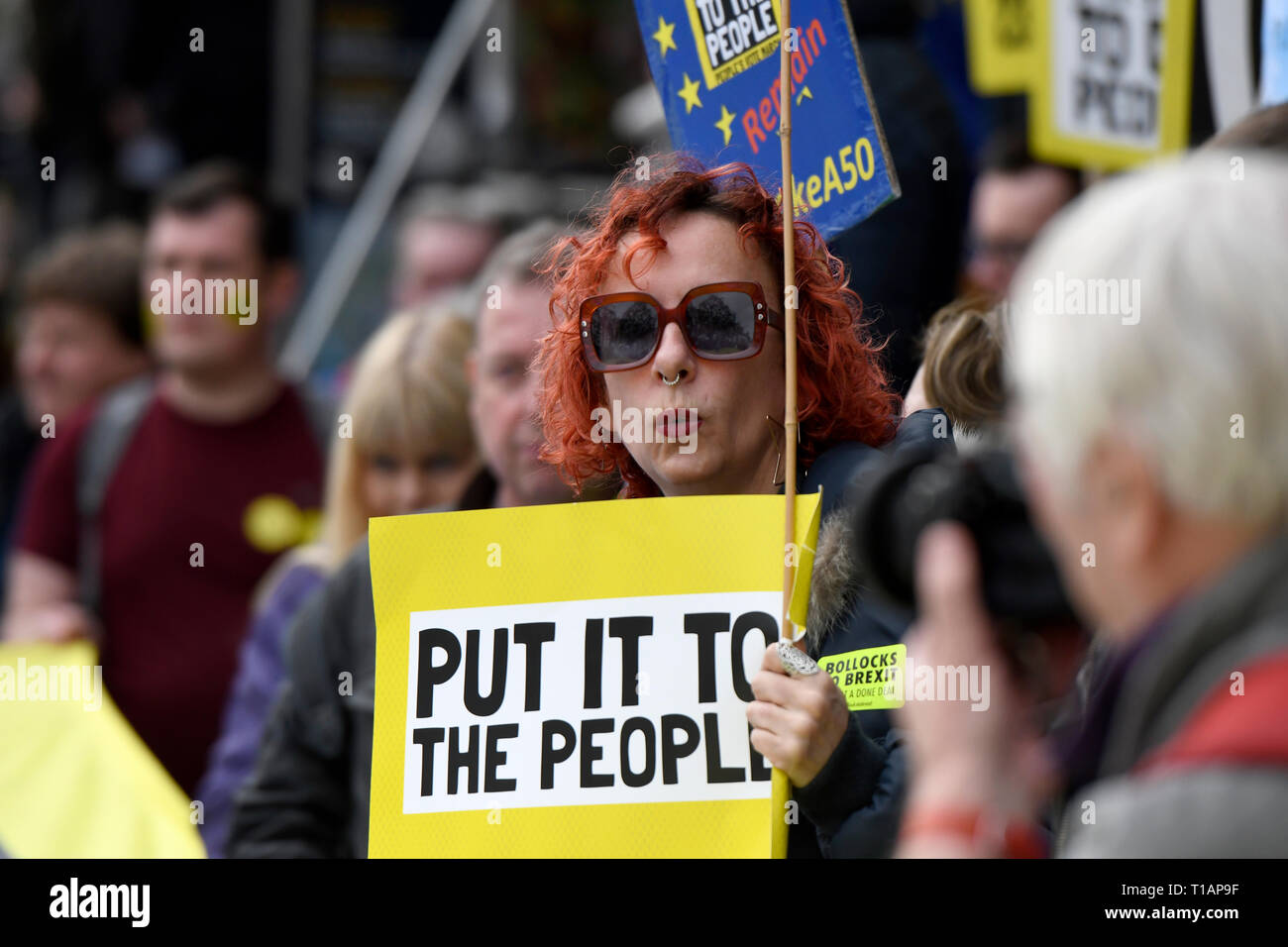 A protester seen holding a placard that says 'Put it to the people' during the march. Over a million people marched peacefully in central London in favor of a second referendum. People gathered at Park Lane to rally at Parliament Square to demonstrate against the Tory government's Brexit negotiations, and to demand a second vote on the final Brexit deal. March was organized by The Peoples Vote. - Stock Image