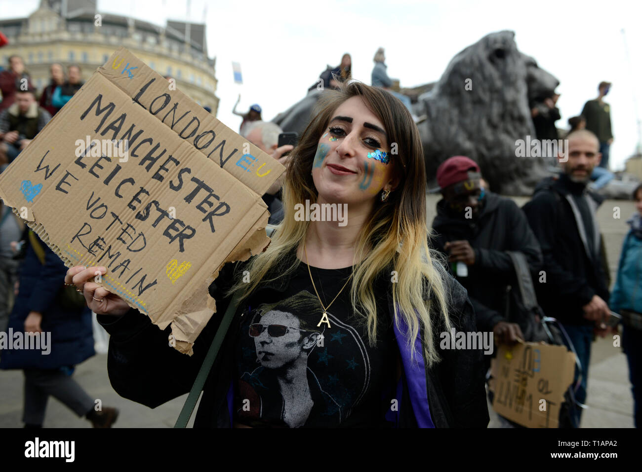 A protester seen holding a placard that says 'Manchester, Leicester we voted remain' during the protest. Over a million people marched peacefully in central London in favor of a second referendum. People gathered at Park Lane to rally at Parliament Square to demonstrate against the Tory government's Brexit negotiations, and to demand a second vote on the final Brexit deal. March was organized by The Peoples Vote. - Stock Image