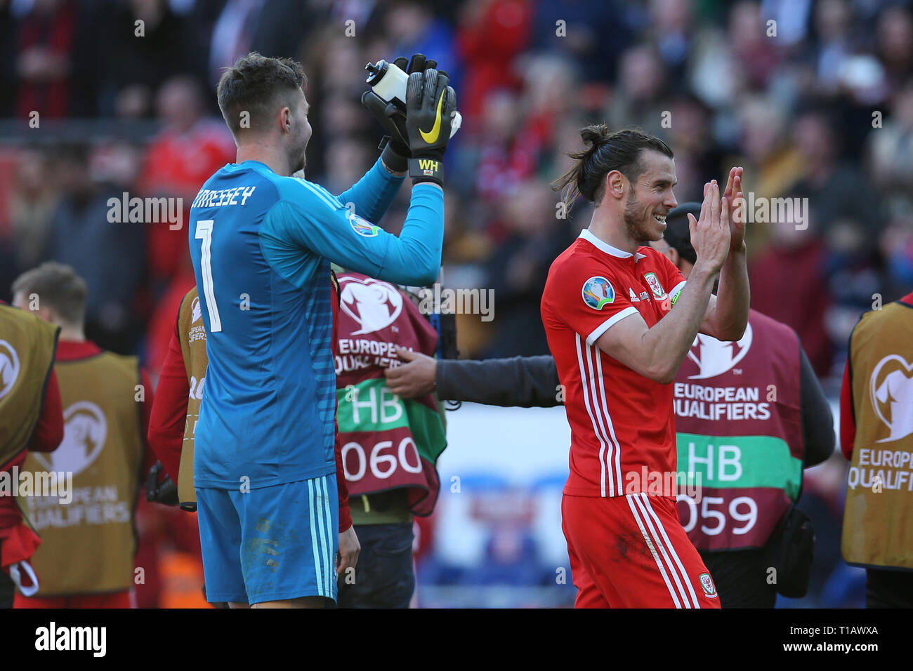 Cardiff, UK. 24th Mar, 2019. Gareth Bale of Wales (right) and Wayne Hennessey, the goalkeeper of Wales after the game. UEFA Euro 2020 qualifier match, group E, Wales v Slovakia at the Cardiff city Stadium in Cardiff, South Wales on Sunday 24th March 2019. pic by Andrew Orchard /Andrew Orchard sports photography/Alamy live News EDITORIAL USE ONLY Credit: Andrew Orchard sports photography/Alamy Live News Stock Photo