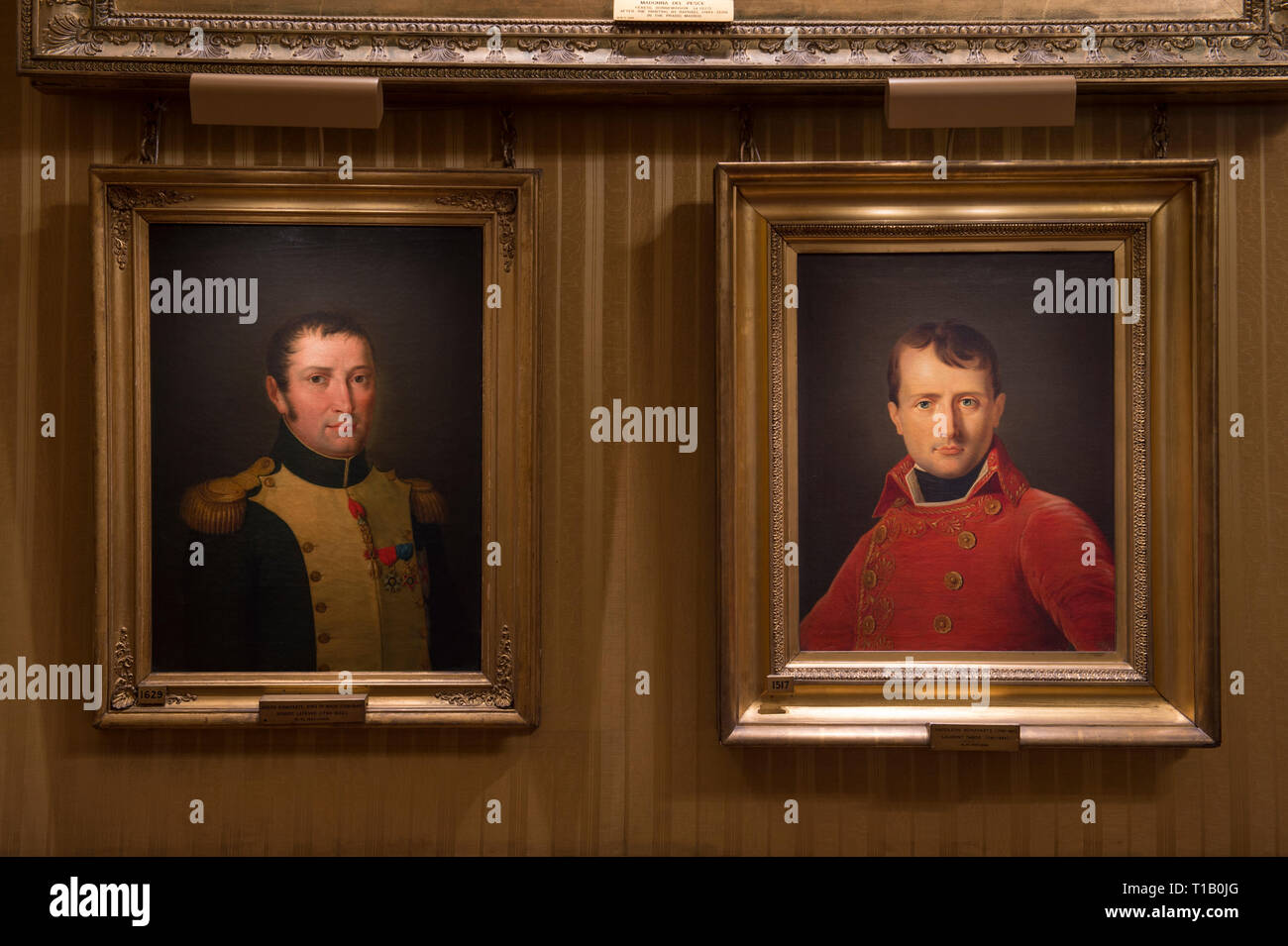 Apsley House, London, UK. 25 March, 2019. 'Young Wellington in India' exhibition explores the early years and provide insights into the man known globally as the 1st Duke of Wellington, who later defeated Napoleon Bonaparte at Waterloo in 1815. The exhibition runs from 30 March - 3 November 2019. Image: Portraits of Wellington's adversary Napoleon Bonaparte and family decorate the walls. Credit: Malcolm Park/Alamy Live News. - Stock Image