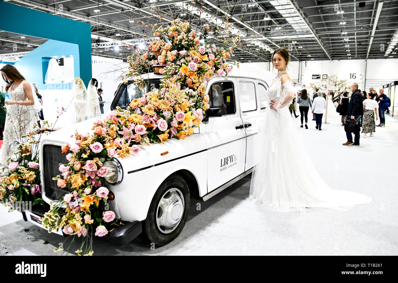 London, UK. 25th Mar 2019. Exhibitor and Model showcases at London Bridal Fashion Week at London Excel on 25 March 2019, UK. Credit: Picture Capital/Alamy Live News - Stock Image