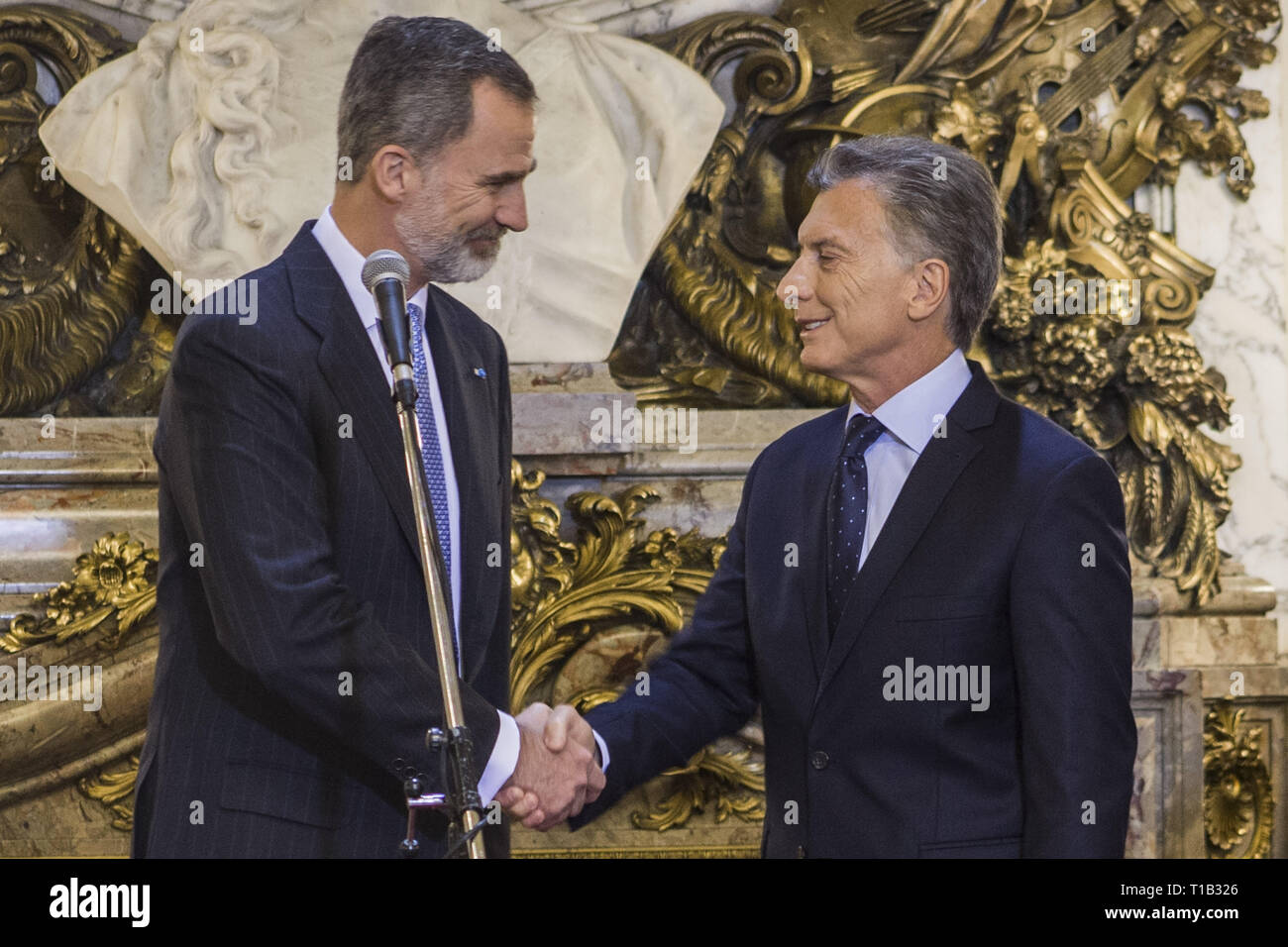 Buenos Aires, Federal Capital, Argentina. 25th Mar, 2019. The King and Queen of Spain, Felipe VI and Letizia Ortiz, arrived on the night of March 24, in Buenos Aires as part of the State visit to Argentina.As expected, the official activities of the monarchs began on Monday, March 25 with a bulky agenda of activities.In the morning, a meeting at the Casa Rosada with President Mauricio Macri and the First Lady, Juliana Awada.The kings arrived at the seat of government where they received honors with the military guard. After taking the official photo in the White Room, Macri and Felipe VI Stock Photo