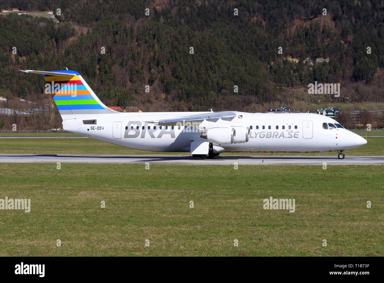 Austria January 4, 2015:British Aerospace Avro RJ100 from Malmö landing at Innsbruck Airport - Stock Image