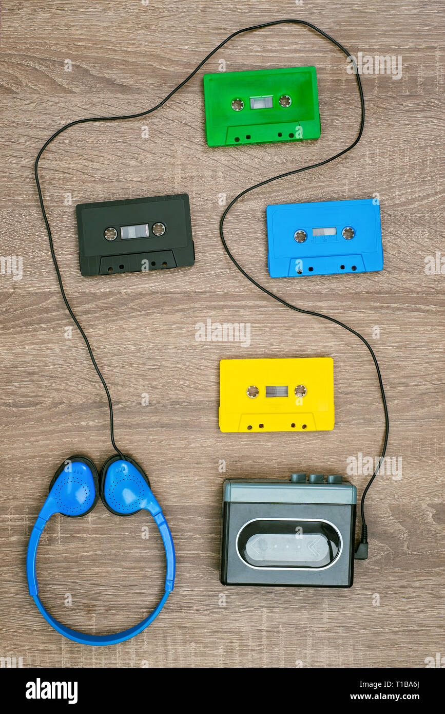 Vintage cassette player, colorful cassete and headphones on the wooden background Stock Photo