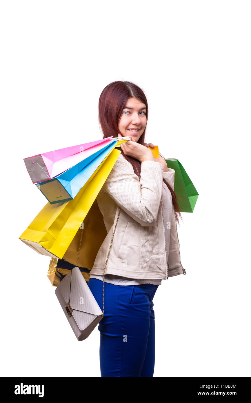 Photo of brunette with multi-colored bags - Stock Image