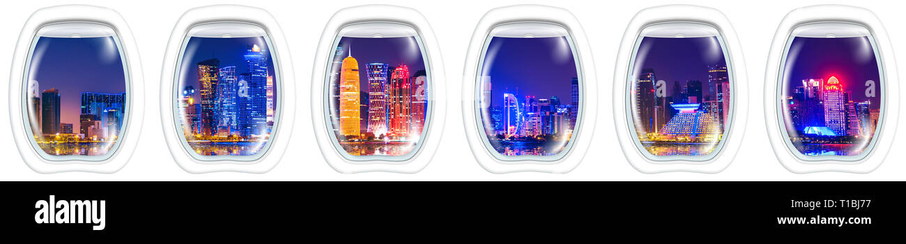 Porthole frame windows on Skyline of Doha city of Qatar in the harbour at blue hour. Night scene waterfront in Doha bay with copy space for Banner - Stock Image