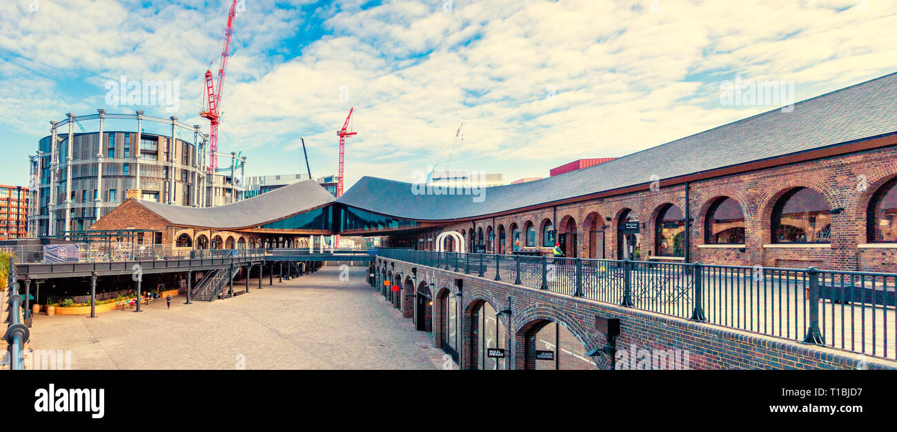 Panorama view of Coal Drops Yard, with its Inception-style roofs, is a retail development in the King's Cross Central scheme in London - Stock Image