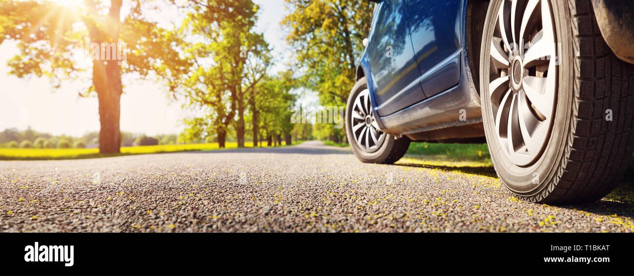 Car on asphalt road in summer - Stock Image